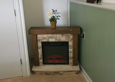 View of the fireplace in the Log Cabin Room