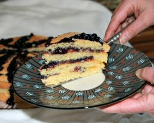 Serving up a 4 layer slice of pancake layered with lemon cured and blueberry sauce - a Carriage Corner specialty
