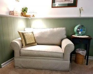 Loveseat in Carriage Corner's Log Cabin Guest Room