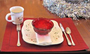 Square Winterberry plates with ruby red bowls make a holiday table that's good through February