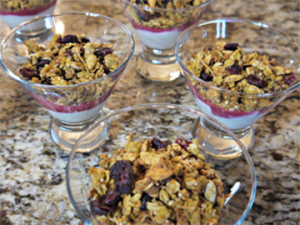 Pumpkin granola layered up with cranberry curd to start your Carriage Corner breakfast off right