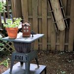 Vintage sled and old cast iron pot bellied stove purchased at the Gordonville Mud Sale