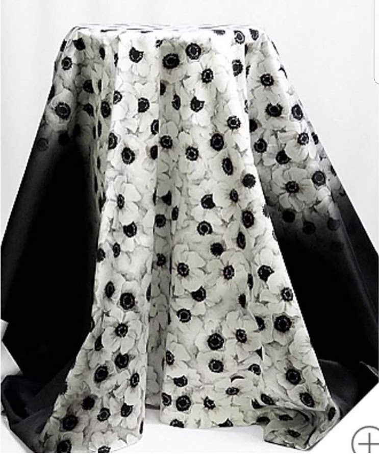 bolt of black and white floral fabric draped over a stool.  This would be the fabric used for the June Sew Camp Challenge