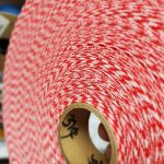 the center of a roll of red gingham bias tape
